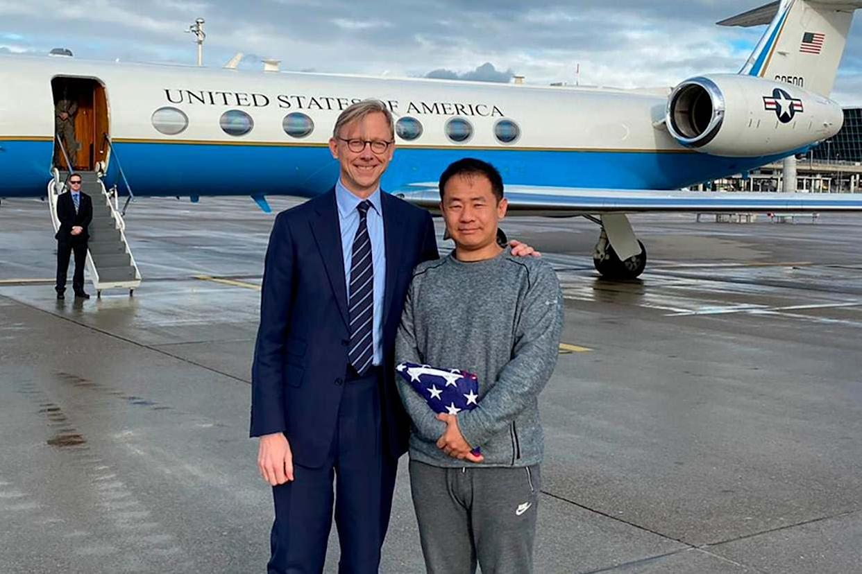 Xiyue Wang, right, with Brian Hook, the US representative for Iran, at an airport in Zurich, Switzerland, following his release from jail in Iran as part of a prisoner swap: AP