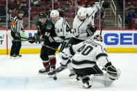 Arizona Coyotes' Jakob Chychrun, not seen, gets the puck past Los Angeles Kings goaltender Calvin Petersen (40) for a goal as Coyotes left wing Michael Bunting (58), Kings defenseman Mikey Anderson (44) and Kings defenseman Drew Doughty (8) watch during the first period of an NHL hockey game Wednesday, May 5, 2021, in Glendale, Ariz. (AP Photo/Ross D. Franklin)