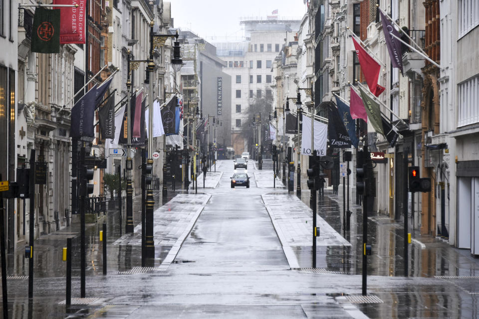 General view of a deserted street in Mayfair, London, Sunday, Feb. 7, 2021, as the third national lockdown, due to the COVID-19 outbreak, continues. (AP Photo/Alberto Pezzali)
