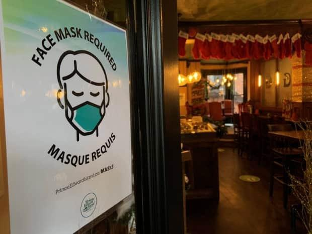 As of midnight Friday, people will no longer have to wear a mask in indoor public spaces in New Brunswick, though many may choose to do so based on their own health circumstances and the nature of the space they are entering.  (Travis Kingdon/CBC - image credit)