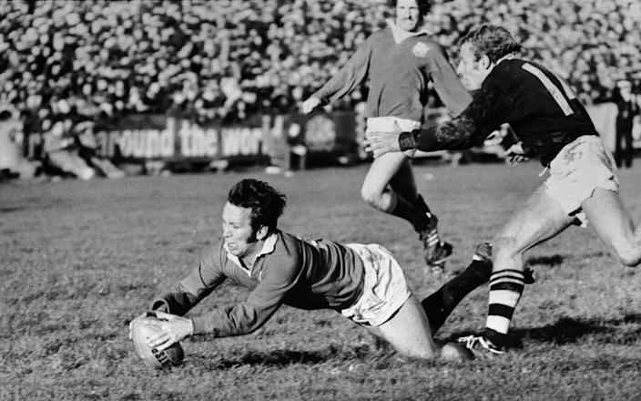 British Lions captain John Dawes gets over the line for a try despite the efforts of Otago winger Bruce Hunter, 18th June 1971 - Central Press/Hulton Archive/Getty Images