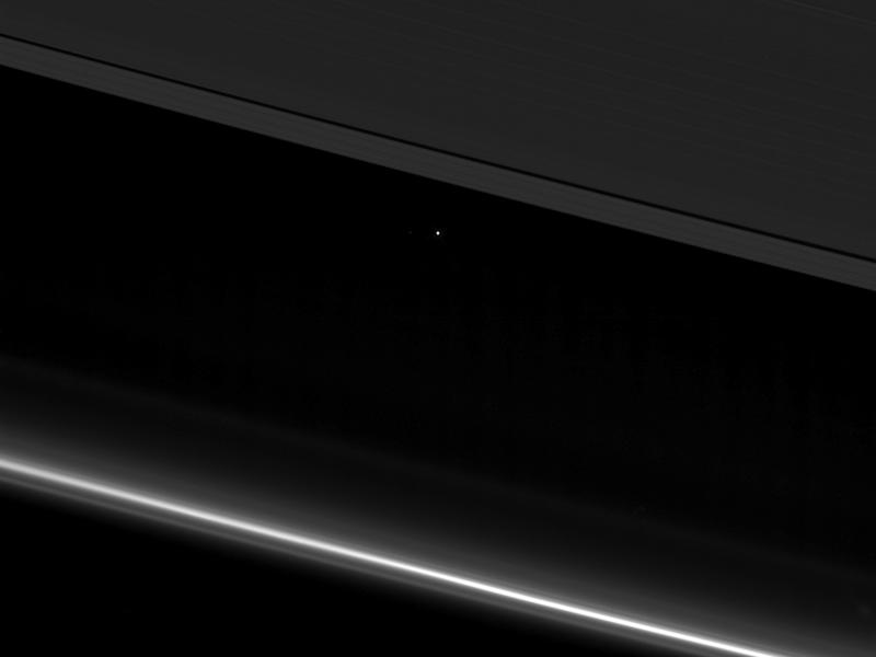 NASA's Cassini spacecraft captured this view of planet Earth as a point of light between the icy rings of Saturn: NASA/JPL-Caltech/Space Science Institute