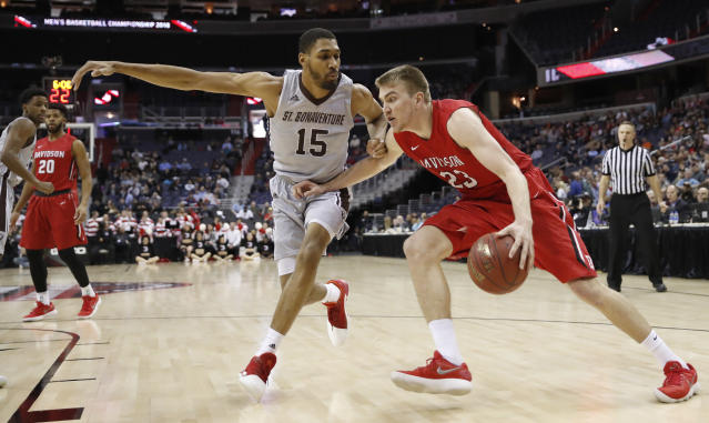 St. Bonaventure forward LaDarien Griffin (15) guards Davidson forward Peyton Aldridge (23) during the first half of an NCAA college basketball game in the semifinals of the Atlantic 10 Conference tournament, Saturday, March 10, 2018, in Washington. (AP Photo/Alex Brandon)