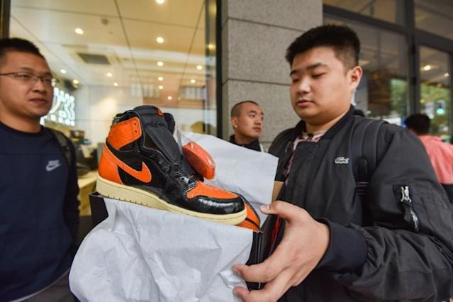 Enthusiasts worldwide have fuelled an expanding bubble in high-priced sneakers, often limited-edition collaborations between big names in sportswear and fashion, rappers or athletes (AFP Photo/STR)