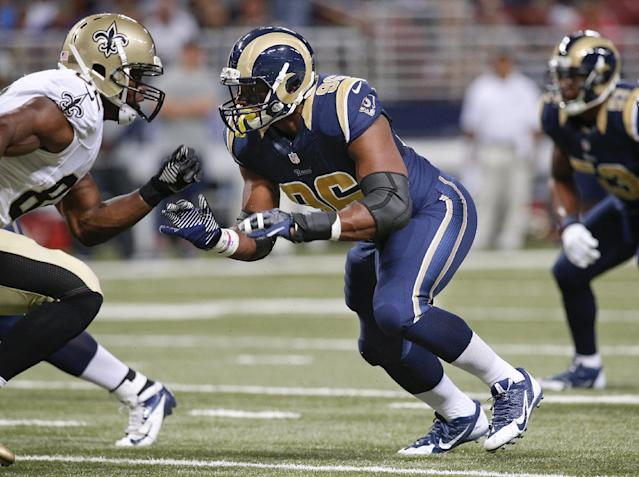 St. Louis Rams defensive end Michael Sam (96) defends New Orleans Saints tight end Benjamin Watson, left, during the first quarter of a preseason NFL football game Friday, Aug. 8, 2014, in St. Louis. (AP Photo/Scott Kane)