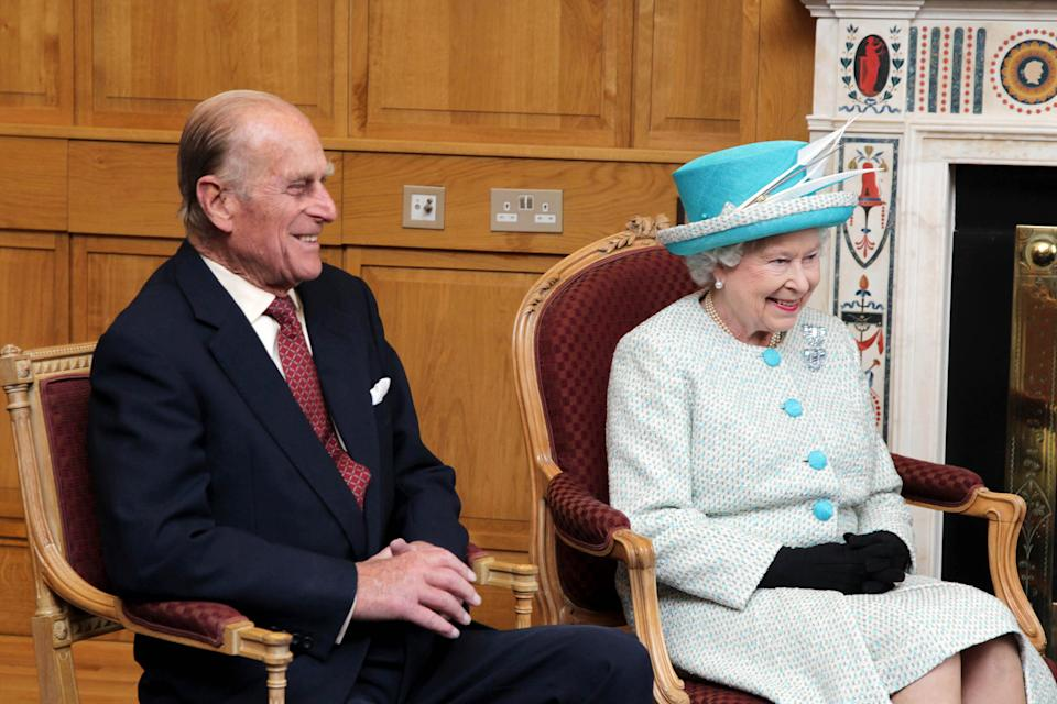 Queen Elizabeth and the Duke of Edinburgh smile while they chat with the Taoiseach in Government Buildings while on the second day of their historic state visit to Ireland - the first visit by a reigning monarch to the republic.