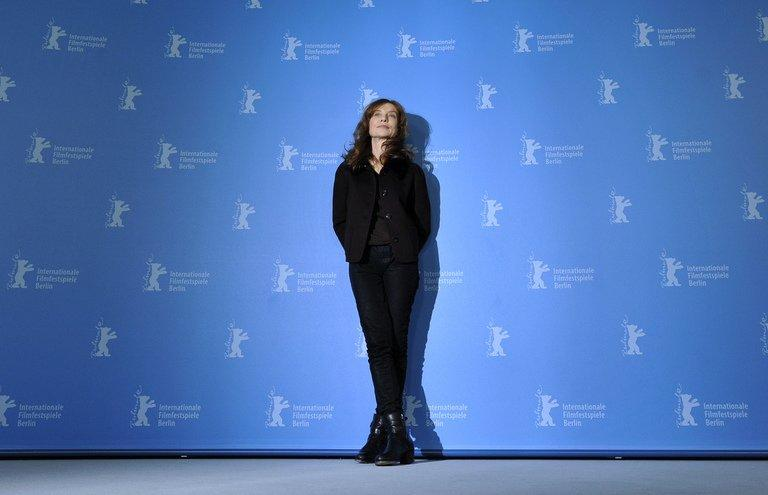 """French actress Isabelle Huppert poses during a photocall for the film """"The Nun"""" ('La Religieuse') presented in the Berlinale Competition of the 63rd Berlin International Film Festival in Berlin on February 10, 2013. Huppert drew warm applause for her turn as a Mother Superior who becomes sexually infatuated with her young charge"""