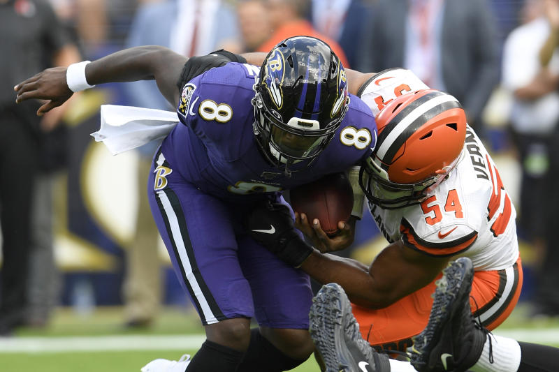 Cleveland Browns defensive end Olivier Vernon (54) sacks Baltimore Ravens quarterback Lamar Jackson (8) during the first half of an NFL football game Sunday, Sept. 29, 2019, in Baltimore. (AP Photo/Nick Wass)