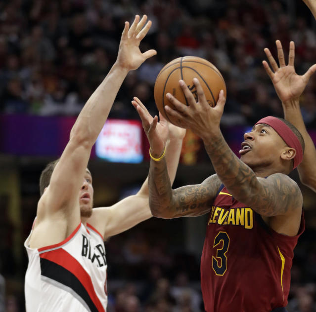 Isaiah Thomas drives to the basket during the second half of Tuesday night's game against the Trail Blazers and Pat Connaughton. (AP)