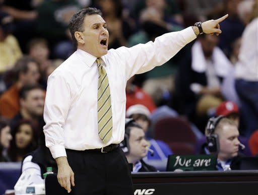 Akron head coach Keith Dambrot reacts during the second half of an NCAA college championship basketball game against Ohio in the Mid-American Conference tournament, Saturday, March 16, 2013, in Cleveland. Akron won 65-46. (AP Photo/Tony Dejak)