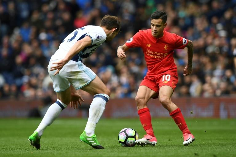 Liverpool are one of the teams Manchester United hope to catch, but fuelled by the form of Philippe Coutinho (R) they have won five times in a seven-match unbeaten run