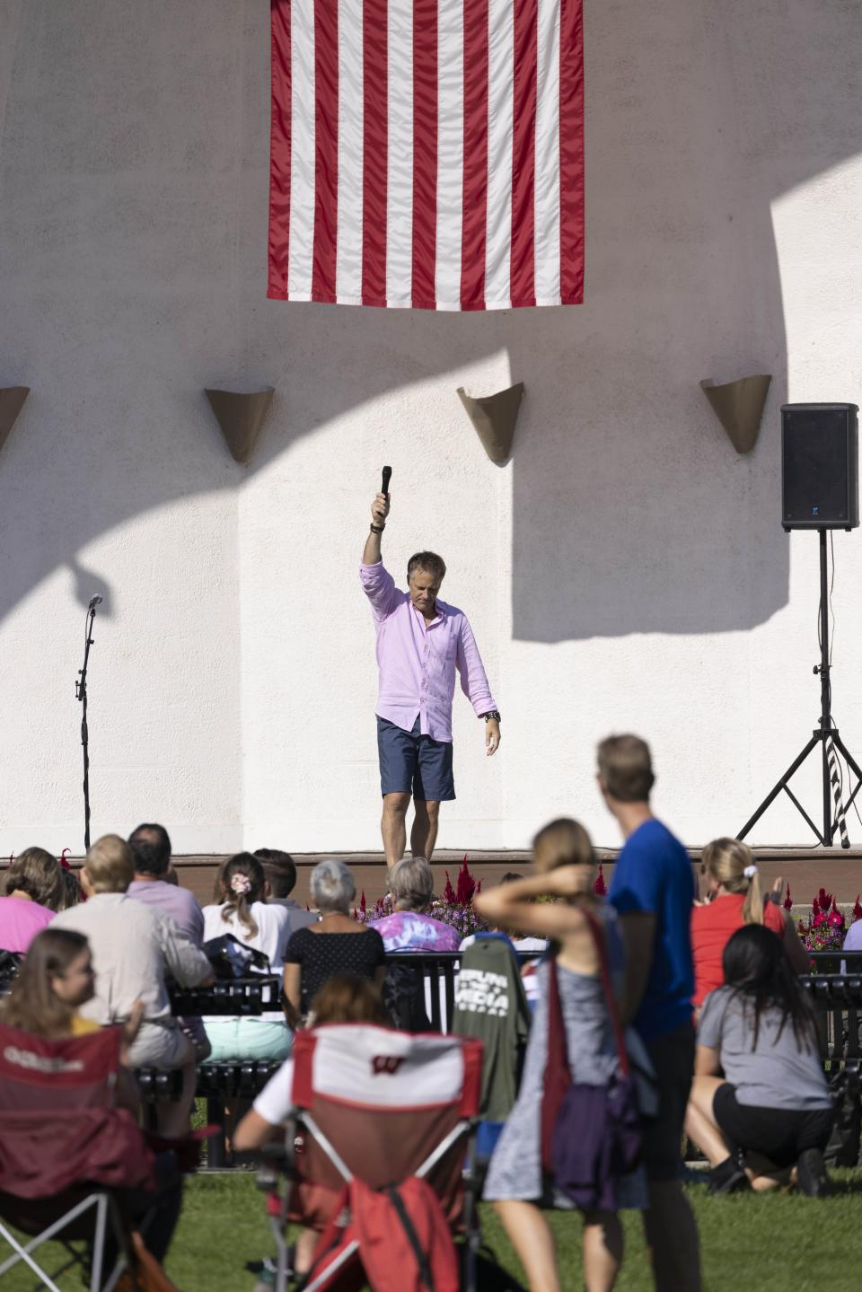 """Wade Anunson, president of the Chiropractic Society of Wisconsin, speaks at the Chiropractic Society Health Freedom revival Sunday, Sept. 19, 2021 in Oconomowoc, Wis. Participants paid $20 per ticket to hear speakers talk about """"health freedom"""" and the risks of vaccines. (AP Photo/Jeffrey Phelps)"""