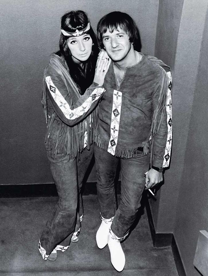 "<b>1966:</b> On a visit to London, Sonny and Cher became hippie-fashion icons during the heyday of Carnaby Street mod. ""We were part of a movement before there was a name for it,"" she says. These Native American-inspired duds were the work of Nudie, the Hollywood tailor who created Elvis Presley's famous gold suit.  <a href=""http://www.instyle.com/instyle/package/transformations/photos/0,,20290120_1179632_1044596,00.html?xid=omg-cher-aguilera-trans?yahoo=yes"" target=""new"">See Christina Aguilera's Style Transformation</a> Hulton-Deutsch Collection/Corbis - August 22, 1966"