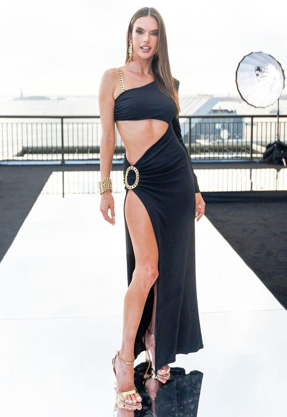 <p><strong>8 September</strong><br></p><p>Alessandra Ambrosio posed in a black cut-out dress at the Dundas x Revolve New York Fashion Week show. </p>
