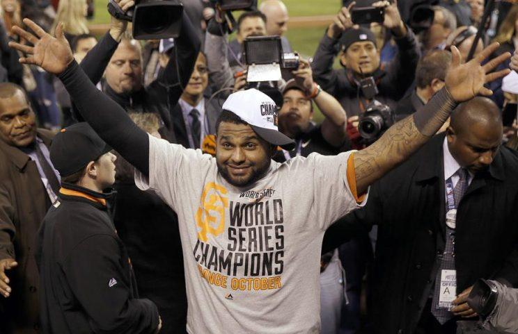 Pablo Sandoval (front) is issued an apology for criticizing the San Francisco Giants after rejoining the organization on Saturday. (AP)