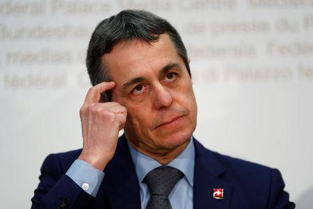 Swiss Foreign Minister Cassis gestures during a news conference in Bern