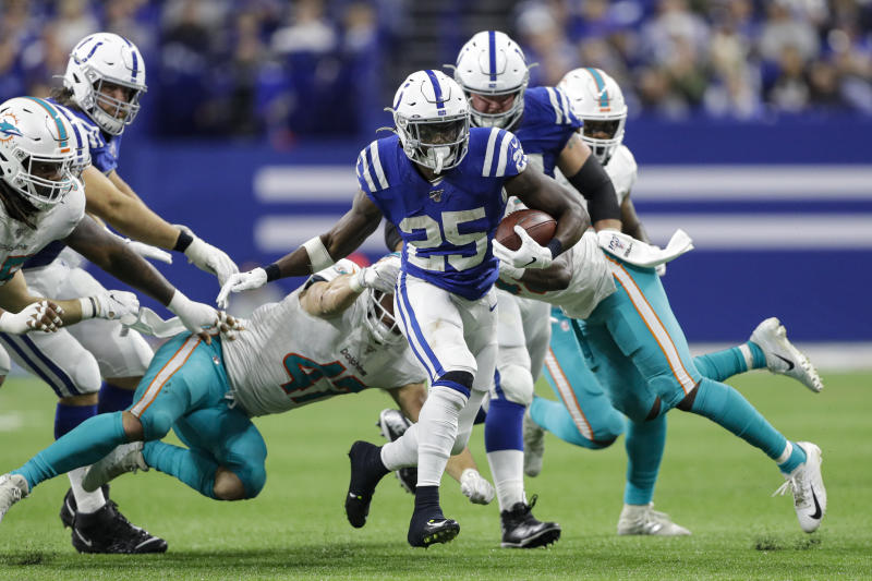 Indianapolis Colts running back Marlon Mack (25) carries against the Miami Dolphins during the second half of an NFL football game in Indianapolis, Sunday, Nov. 10, 2019. (AP Photo/Darron Cummings)