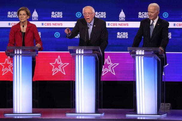 PHOTO: Democratic presidential candidates look on during the Democratic presidential primary debate at the Charleston Gaillard Center, Feb. 25, 2020, in Charleston, South Carolina. (Win Mcnamee/Getty Images)