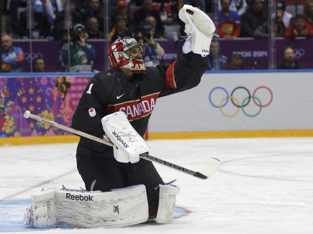 Canada's goalie Roberto Luongo makes a save against Austria during the second period of their men's preliminary round ice hockey game at the 2014 Sochi Winter Olympic Games, February 14, 2014. REUTERS/Phil Noble (RUSSIA - Tags: SPORT ICE HOCKEY OLYMPICS)