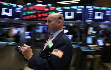 A trader works on the floor at the New York Stock Exchange (NYSE) in New York City