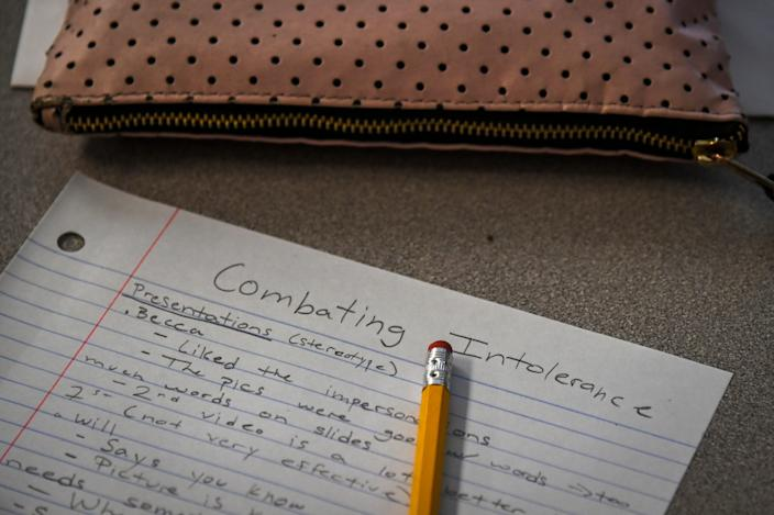 A student takes notes in Julia Braxton's Combating Intolerance class at McLean High School on Friday, September 27, 2019, in McLean, VA. Combating Intolerance has been offered at a handful of Fairfax County high schools, but this is the first time the class is being offered at McLean High School.