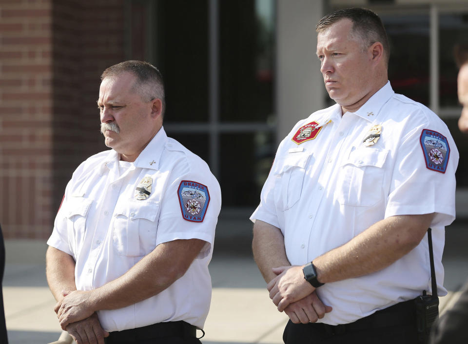 Draper Battalion Chiefs Bart Vawdrey and Kevin Holt listen during a press conference in Draper, Utah, on Tuesday, Aug. 14, 2018. Draper Battalion Chief Matthew Burchett died battling the largest recorded wildfire in California history. (Jeffrey D. Allred/The Deseret News via AP)