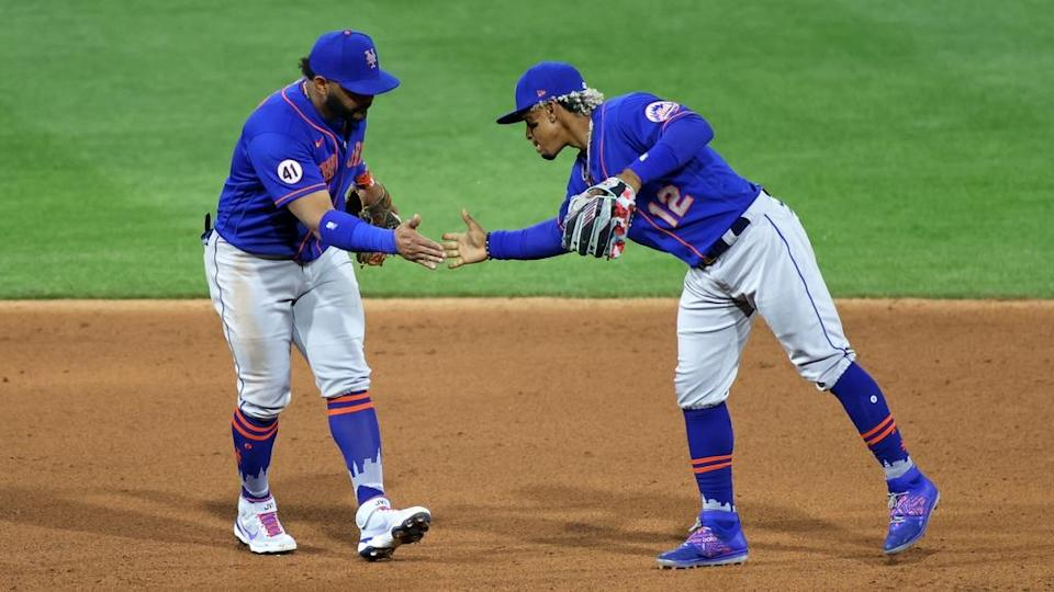 Francisco Lindor and Jonathan Villar celebrate win