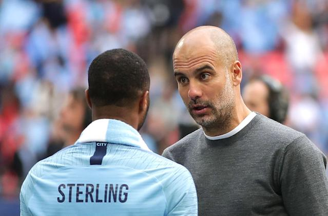Pep Guardiola, Manager of Manchester City speaks to Raheem Sterling of Manchester City after they won the FA Cup Final match between Manchester City and Watford at Wembley Stadium.