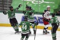 Dallas Stars Jamie Benn (14), Joel Hanley (44), Jason Dickinson (18) and Sami Vatanen (45) celebrate a second-period goal by right wing Denis Gurianov against the Columbus Blue Jackets during an NHL hockey game on Thursday, April 15, 2021, in Dallas. (AP Photo/Richard W. Rodriguez)