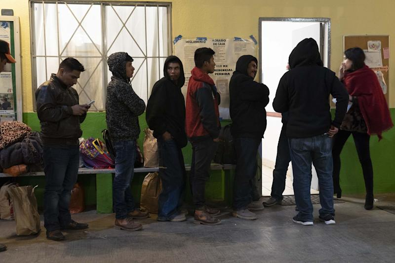 Migrants from Central America in a Tijuana, Mexico, February 2019, wait to meet with U.S. immigration officials.