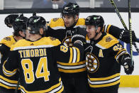 Boston Bruins' Patrice Bergeron (37) celebrates his goal with teammates during the first period of an NHL hockey game against the Washington Capitals, Sunday, April 18, 2021, in Boston. (AP Photo/Michael Dwyer)