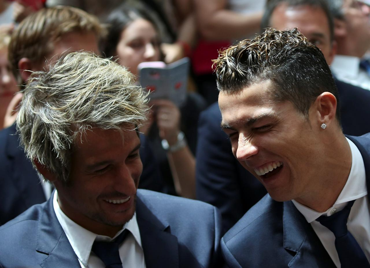 Real Madrid's Cristiano Ronaldo and teammate Fabio Coentrao attend a ceremony after winning La Liga title at the headquarters of Madrid's regional government in Madrid, Spain, May 22, 2017. REUTERS/Susana Vera