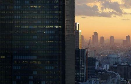 High-rise office buildings are seen during sunset in Tokyo