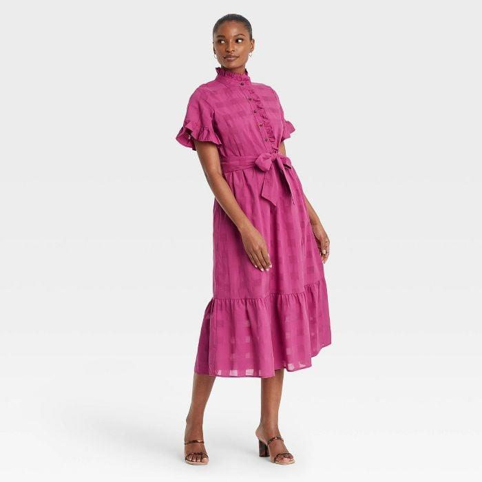 <p>Warning: this <span>Who What Wear Ruffle Short Sleeve Dress</span> ($40) wasn't made for sartorial wallflowers. With ruffled details and a bright-pink hue, this number was designed to make you stand out - and be best dressed in the process.</p>