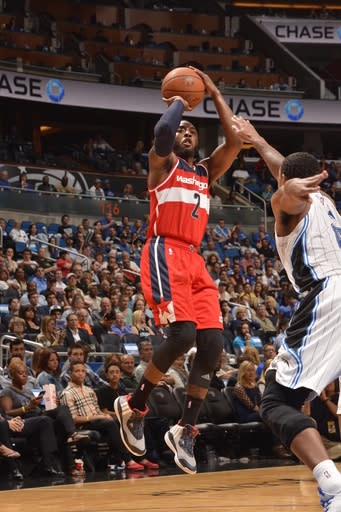 Wall's layup helps Wizards hold off Magic, 105-98