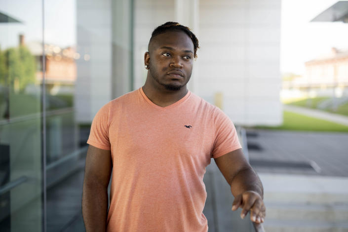 In this Saturday, July 20, 2019 photo, Sanjay Johnson poses for a photo, in Downtown Little Rock, Ark. Johnson was accused of exposing a sexual partner to HIV. Prosecutors in Little Rock pursued a criminal charge against Johnson even though a doctor said he couldn't have transmitted HIV because he was on medication that suppressed his virus. In roughly 20 states, it's a crime for people with HIV to have sex without first informing their partner of their infection. (AP Photo/Gareth Patterson)