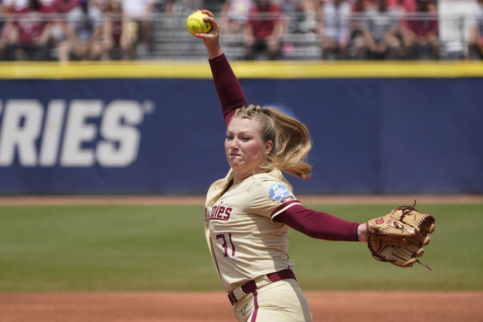 Florida State's Danielle Watson (31) pitches in the first inning against Oklahoma in the final game of the NCAA Women's College World Series softball championship series Thursday, June 10, 2021, in Oklahoma City. (AP Photo/Sue Ogrocki)