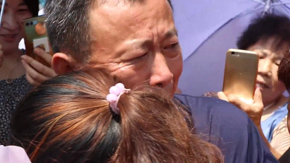 Jin Ting is seen hugging a man here during the emotional reunion. The now 33-year-old was not seen or heard from again, leaving her dad, Jin Guosheng, and mum, Chen Meiliang, on a country-wide search.