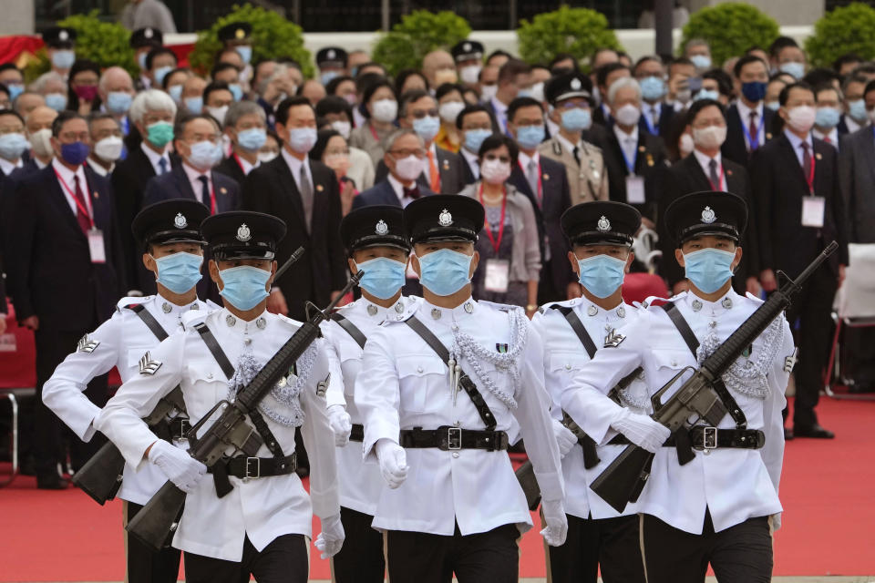Guard of honour march to the flag raising ceremony at the Golden Bauhinia Square for the celebration of 24th anniversary of Hong Kong handover to China, in Hong Kong, Thursday, July 1, 2021. (AP Photo/Kin Cheung)