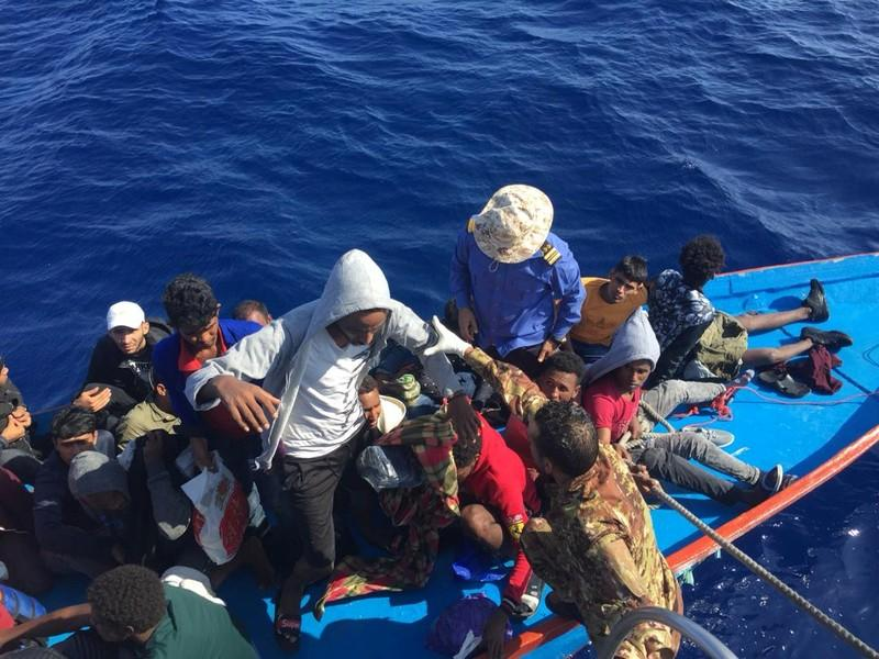 Migrants are seen in a dinghy as they are rescued by Libyan coast guards at the Mediterranean Sea off the coast of Libya