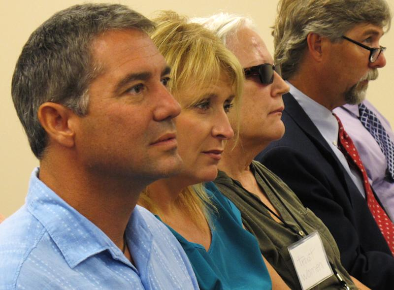 Troy Newman, far left, president of the anti-abortion group Operation Rescue, follows arguments from attorneys during a meeting of the Kansas State Board of Healing Arts before it decides to revoke Dr. Ann Kristin Neuhaus' medical license, Friday, June 22, 2012, in Topeka, Kan. The State Board of Healing Arts ratified an administrative judge's earlier decision to strip Dr. Ann Kristin Neuhaus of her license. Neuhaus provided second opinions that Tiller needed under Kansas law to perform some late-term abortions at his Wichita clinic. Tiller, one of a few U.S. physicians known to perform abortions in the final weeks of pregnancy, was shot to death in May 2009 by a man professing strong anti-abortion views. (AP Photo/John Hanna)