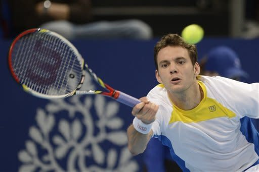 France's Paul-Henri Mathieu returns a ball to Russia's Nikolay Davydenko during their round of sixteen match at the Swiss Indoors tennis tournament at the St. Jakobshalle in Basel, Switzerland, on Thursday, Oct. 25, 2012. (AP Photo/Keystone/Georgios Kefalas)