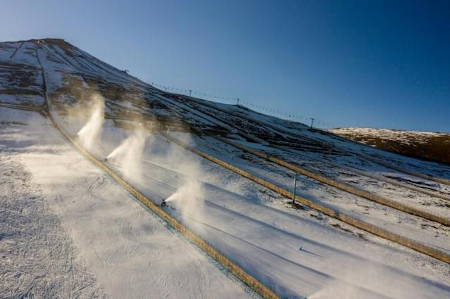 Aerial view of snow cannons spraying artifical snow on a ski slope at El Colorado skiing center in Chile, where climate change and pollution have resulted in diminishing snowfall (AFP Photo/MARTIN BERNETTI)