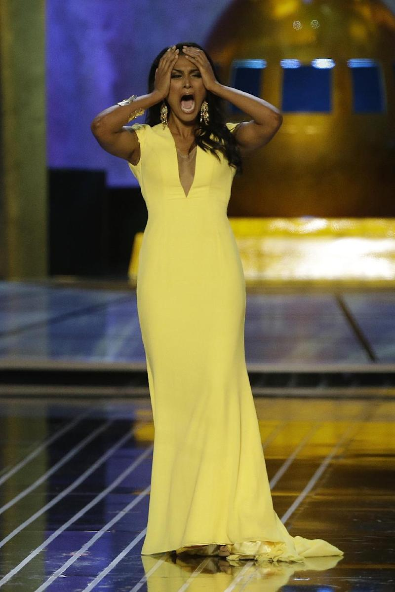 Miss New York Nina Davuluri reacts after being named Miss America 2014, Sunday, Sept. 15, 2013, in Atlantic City, N.J. (AP Photo/Mel Evans)