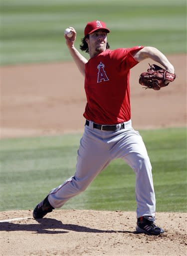 Los Angeles Angels starting pitcher Dan Haren throws to the Arizona Diamondbacks during the second inning of a spring training baseball game Tuesday, March 13, 2012, in Scottsdale, Ariz. (AP Photo/Marcio Jose Sanchez)