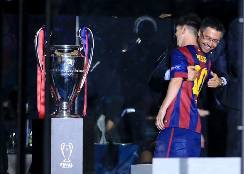 Barcelona's president Josep Maria Bartomeu celebrates with Lionel Messi before the trophy presentation