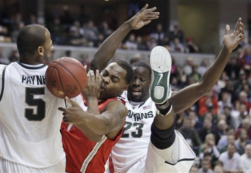 Ohio State forward Deshaun Thomas vies for a rebound between Michigan State center Adreian Payne (5) and forward Draymond Green (23) in the first half of an NCAA college basketball game in the final of the Big Ten Conference men's tournament in Indianapolis, Sunday, March 11, 2012. (AP Photo/Michael Conroy)