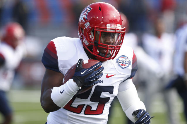 Arizona running back Ka'Deem Carey (25) runs with the ball during a drill prior to the start of the AdvoCare V100 Bowl NCAA college football game against Boston College, Tuesday, Dec. 31, 2013, at Independence Stadium in Shreveport, La. (AP Photo/Rogelio V. Solis)