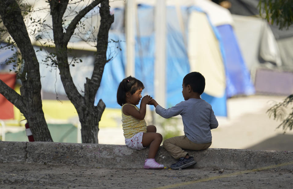 Children play at a camp of asylum seekers stuck at America's doorstep, in Matamoros, Mexico, on Wednesday, Nov. 18, 2020. Like countless schools, the camp's so-called sidewalk school as it became known went to virtual learning amid the coronavirus pandemic but instead of being hampered by the change, it has blossomed. (AP Photo/Eric Gay)