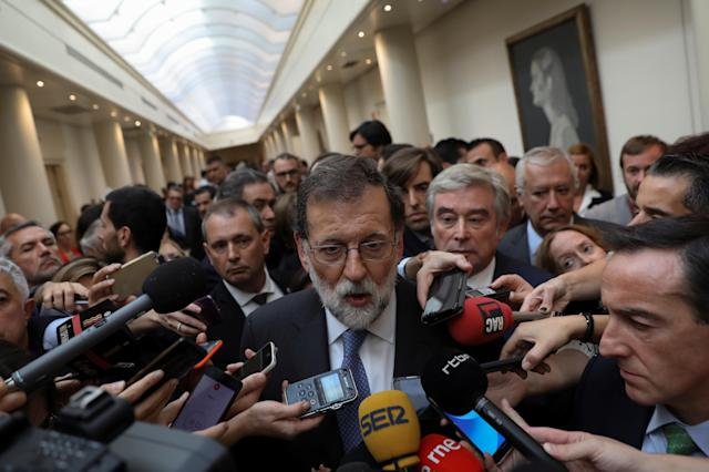<p>Spain's Prime Minister Mariano Rajoy talks to reportes after a plenary session at the upper house Senate in Madrid, Spain, Oct. 27, 2017. (Photo: Susana Vera/Reuters) </p>